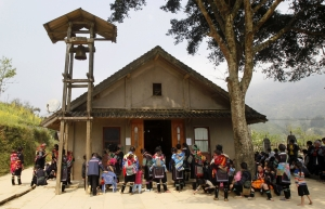 Ethnic Hmong Catholics attend a Eucharistic adoration ceremony at the Lao Chai church, near Sapa resort town, in Vietnam