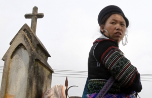 An ethnic Hmong woman attends a Eucharistic adoration ceremony at the Lao Chai church, near Sapa resort town, in Vietnam